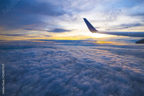 Garden Poster Airplane Beautiful view from window of airplane in sunrise sky