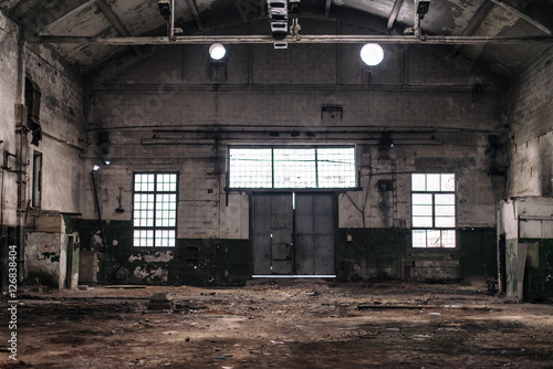 Photo Stands Old abandoned buildings Abandoned industrial factory interior.