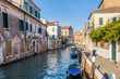 Streetview with bridge and old buildings in Venice Italy.