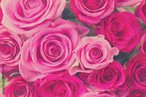 Fotografiet round bouquet of pink and magenta roses close up background, retro toned