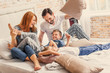 Leinwandbild Motiv Young family being playful at home