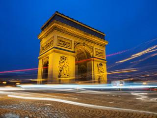 Fototapeta na wymiar The Triumphal Arch at night in Paris, France