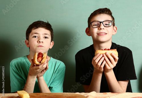 teenager school boys cooking eat hot dog