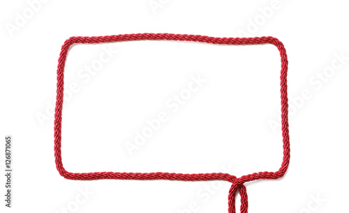 Photo  Rectangular frame of red cord with ends