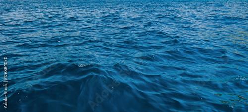 Poster Zee / Oceaan Blue and Dark water surface at deep ocean