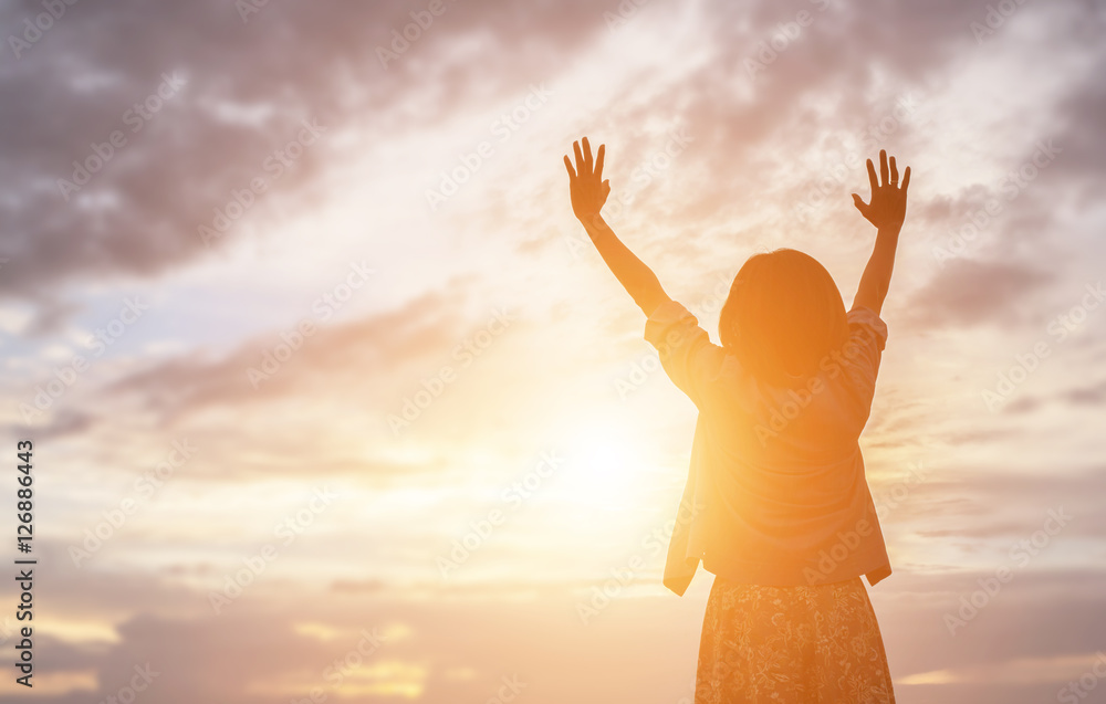 Fototapeta Silhouette of woman praying over beautiful sky background