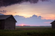 Summer Sun Sets Between The Barn Houses