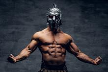 Muscular Man In A Gladiator Silver Helmet.