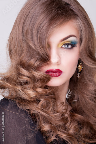 Obraz na plátně  Gorgeous girl with make up and hairstyle