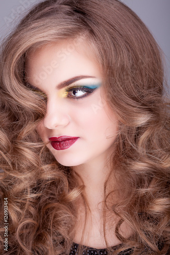 Obraz na plátně  Beauty portrait of girl with red lips and colored make up