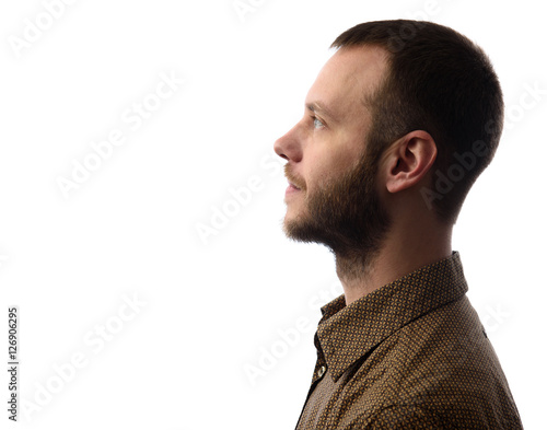 Valokuva  Side view of young bearded man isolated