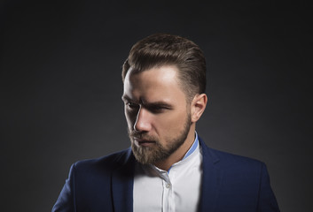 Handsome bearded young man wearing suit. Studio portrait