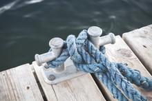 Mooring Bollard With Tied Blue Rope