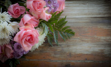 Bouquet Of Flowers On A Rustic Background