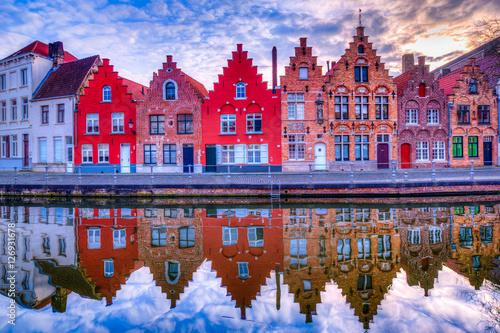 Foto op Canvas Brugge Medieval buildings along a canal in Bruges, Belgium