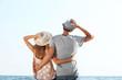 Happy couple on blue sky background