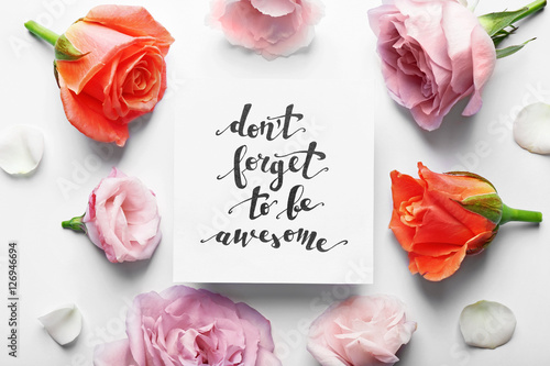 "Photo  Inscription ""DON'T FORGET TO BE AWESOME"" written on paper with flowers on white"