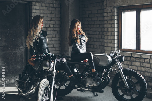 Bikers women in leather jackets with motorcycles