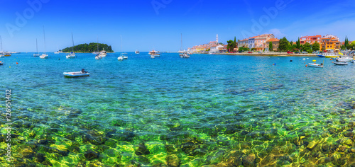 Spoed Foto op Canvas Stad aan het water Wonderful romantic old town at Adriatic sea. Boats and yachts in harbor crystal clear turquoise water at magical summer. Rovinj. Istria. Croatia. Europe.
