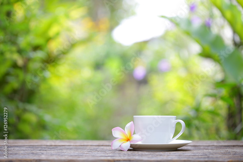Wall Murals Cafe white cup and frangipani flower at outdoor