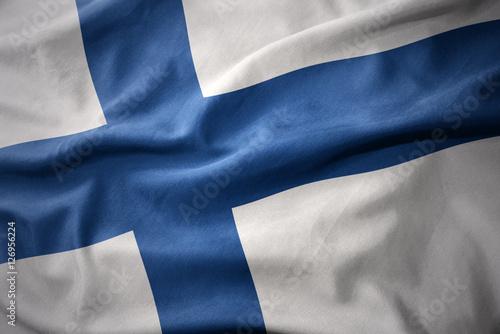 waving colorful flag of finland. Obraz na płótnie