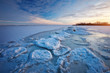 Winter landscape with frozen lake and sunset sky. Composition of