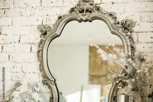 Obraz Vintage interior with a mirror in beautiful frame - fototapety do salonu