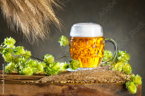 Photo Glass of beer and raw material for beer production