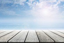 Empty Old Wooden Table With Ocean And Blue Skies Background Blurred. Concept Summer, Beach, Sea, Ocean, Relax.
