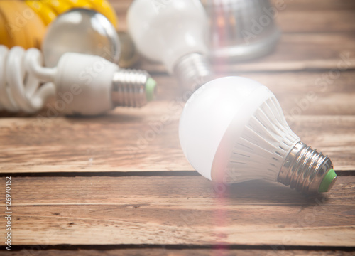 Fényképezés  LED bulb and Incandescent bulbs on the wooden