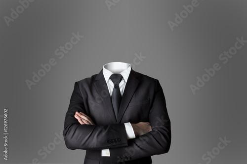 businessman without head crossed arms grey background Fototapeta