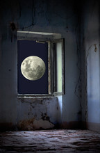 Fantastic View Of A Moon Through A Window Of The Abandoned House