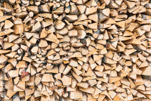 Tuinposter Brandhout textuur Firewood texture background. Close-up of chopped firewood.