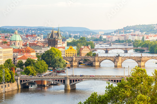 Fototapeta Panorama of the old part of Prague from the Letna park. Beautiful view on the bridges over the river Vltava at sunset. Old Town architecture, Czech Republic. obraz na płótnie