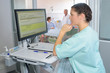 Nurse reading patient's notes on computer screen