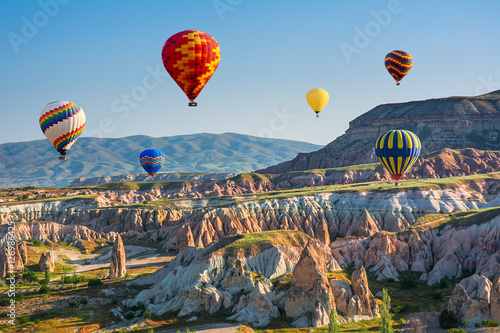 Poster de jardin Montgolfière / Dirigeable The great tourist attraction of Cappadocia - balloon flight. Turkey