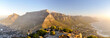 canvas print picture - XXL panorama of Table Mountain and the Twelve Apostles mountain range seen from Lion's Head near Signal Hil in the evening sun. Camps Bay on the right, city of Cape Town on the left. South Africa.