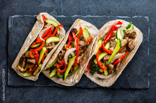 Stampe  Mexican pork tacos with vegetables. Top view