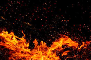 Fototapeta na wymiar Bonfire flames over black background