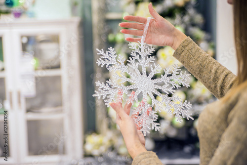 Fotografie, Obraz  Woman's Hand Holding Snow Flake Decoration