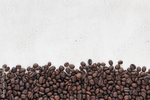 Fototapety, obrazy: coffee beans on white wood background, over light