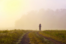 Alone Girl On Bicycle Riding Through Morning Misty Nature, Original Sport Wallpaper