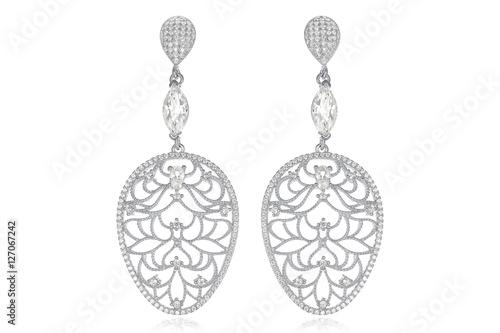 Fényképezés  Silver earrings on white background