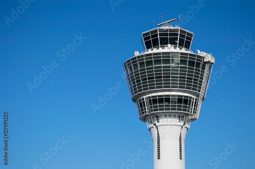 Foto op Aluminium Luchthaven Modern air traffic control tower in international passenger airport over clear blue sky