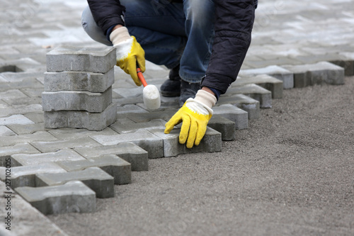 Paving stone worker Fotobehang