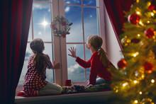 Girls Sitting By Window