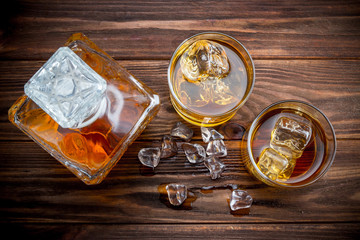 Decanter and two glasses with ice and whiskey
