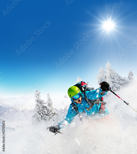 Fotobehang Wintersporten Freeride skier on piste running downhill