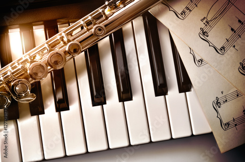 Piano and flute with golden shine and sheet music top Canvas Print