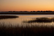 Warm Sky Over A Marsh At Milfo...